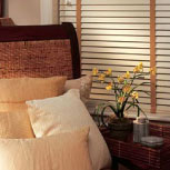 Two inch wooden blinds add a timeless style to your home or commercial space.